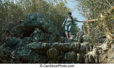 A woman descends the mountain