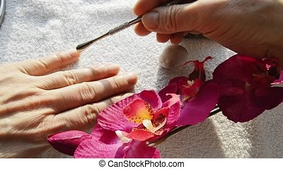 A woman does her own manicure at home. Manicure and Spa accessories, hands close-up.