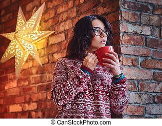A woman drinks coffee.