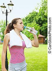 woman drinks water
