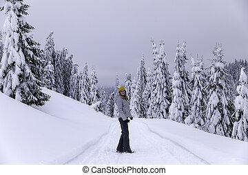 A woman enjoying the winter in a beautiful mountain landscape