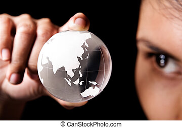 Asia and Australia continent - A woman examining a glass...