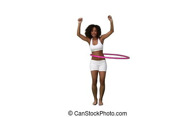 A woman exercising with a hula hoop