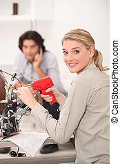 A woman fixing a TV.