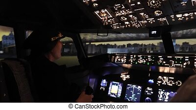 A girl pilot is flying a plane. A woman is holding a flywheel over an air simulator under the bridge