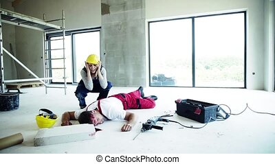 A woman found man worker lying unconscious on the floor at the construction site.