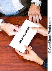 a woman handing a job application to her boss