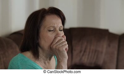 A woman with symptoms of coronavirus at home