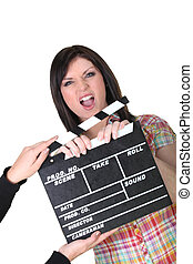 a woman having a hand caught in a movie clap