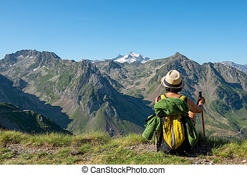 woman hiker looking at the Pyrenees mountains