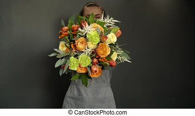 A woman holding a florist in her hands a beautiful bouquet