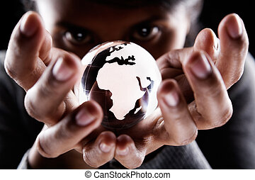 Africa and Europe continent - A woman holding a glass globe...