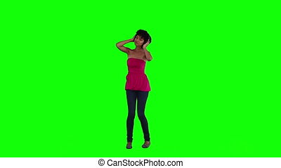 A woman holding her head is dancing
