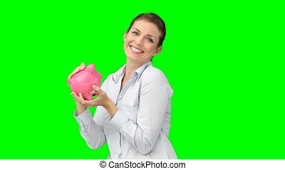 A woman holding her piggy-bank and kissing it