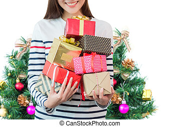 A woman holding many of Christmas gift boxes over white background