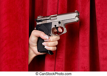 A revolver is a woman hand with a red curtain shelved
