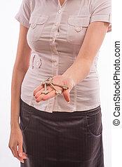 A woman holds a set of keys
