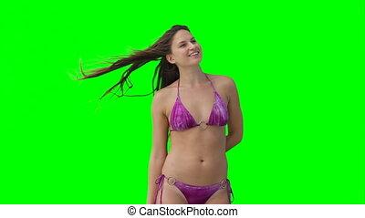 A woman in a bikini posing