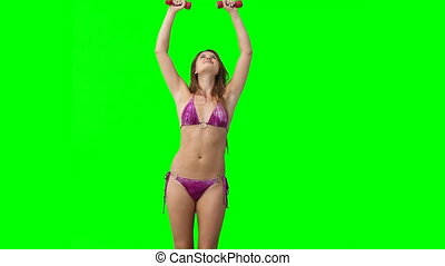 A woman in a bikini works out