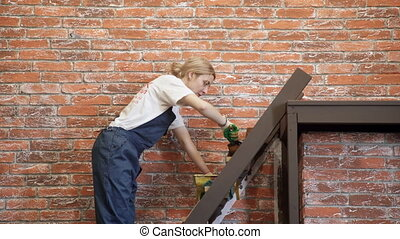 A woman in a blue jumpsuit with a brush color brown stairs....