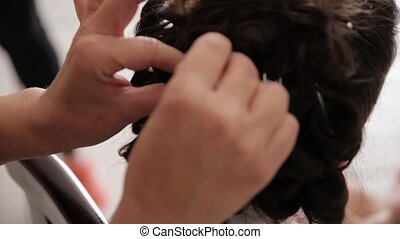A woman in a hairdressing salon