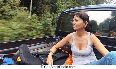 A woman in a pickup truck