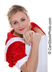 A woman in Christmas clothes.