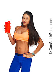 A  woman in colorful sportswear holding bottle of water.