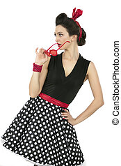 A woman in fifties-style clothes. Beautiful retro girl.
