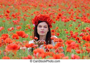 A woman in poppy field