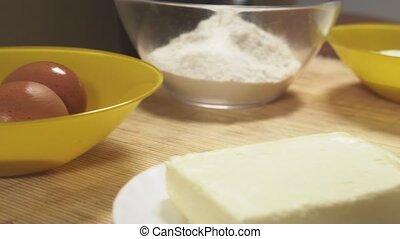 A woman in the kitchen makes a lemon cake. 4k, slow-motion shooting. bodily shot