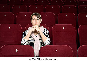 A woman in the movie theatre