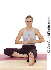 yoga - a woman is doing some yoga exercises