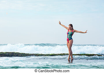 A woman is flying over the waves