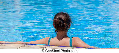 A woman is in the swimming pool