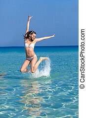 A woman is jumping in water