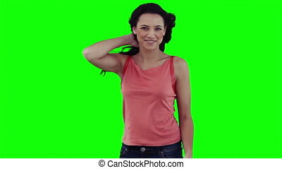 A woman is posing for the camera