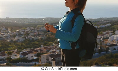 A woman is taking pictures on the phone. Travel concept