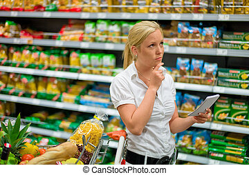 selection in a supermarket - a woman is unable to cope with ...