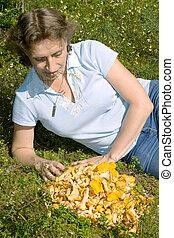 A woman lies on a lawn