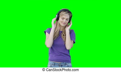 A woman listening to music on headphones
