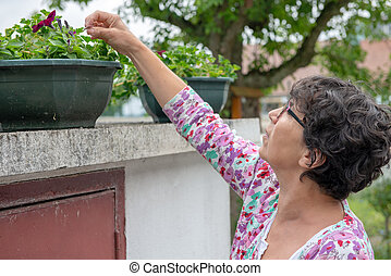 woman looking at the flowers in the garden