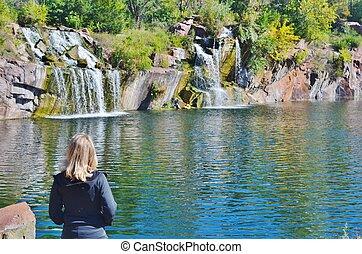 A woman looking at waterfalls.