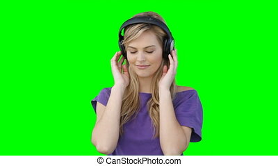 A woman moving to the music on her headphones