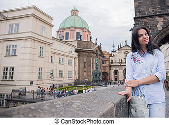 woman on Charles bridge in Prague