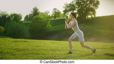 A woman performs squats on one leg with a backward lunge and...