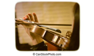 A woman playing the violin bow. retro style film 1960s. - A...