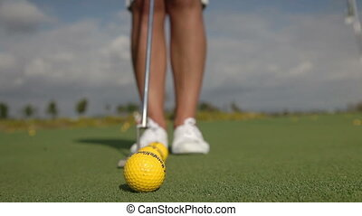 a woman plays golf on a nice sunny day