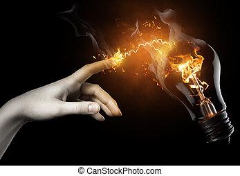 illuminated bulb - a woman pointing to the illuminated bulb