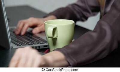 A woman poured tea onto a laptop. works in the office, 4k...